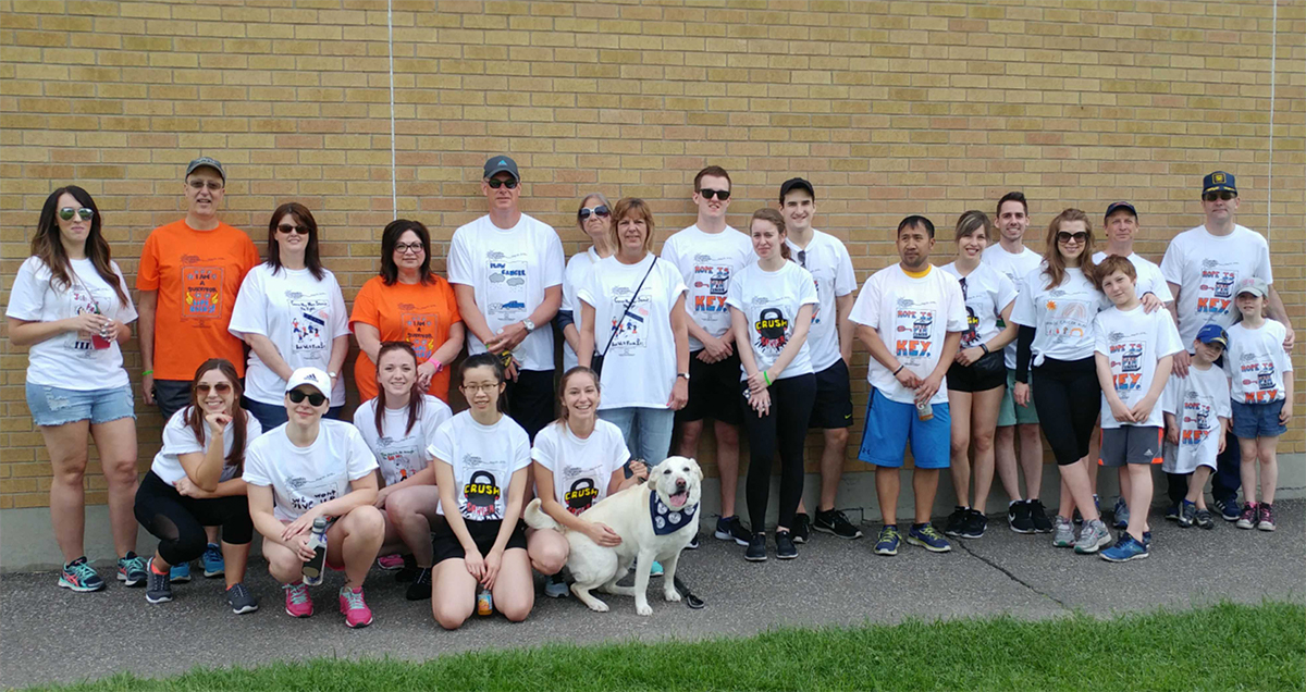Family and co-workers of Gryphon's Brad Green participate in Rankin Cancer Run.