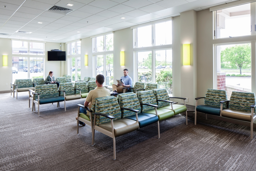 Existing tall windows with views toward Back Cove combine with earthy and watery colors in the waiting area.